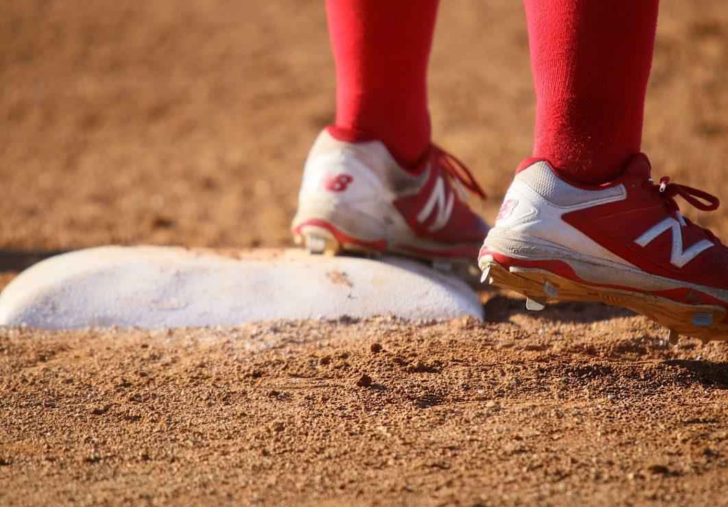 Santa Rosa Junior College player's shoes touch the base. (Photo gallery by Lidiya Grib)