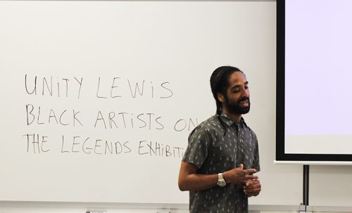 Unity Lewis gives a lecture on the role his grandmother played in the Black Artist movement. Lewis gave the lecture in fine and applied arts room 505 on March 15. (Photo by Jared Smith)