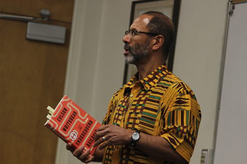 "American River College history professor Rudy Pearson reads a passage from Colson Whitehead's novel ""Underground Railroad"" during a College Hour on March 23, 2017. The novel details a slave girl's life and escape from a Georgia plantation. (Photo by Mack Ervin III)"