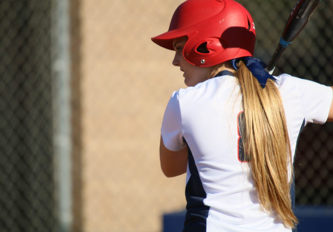 ARC softball infield Sierra Cryderman prepares to bat the ball. (photo gallery by Lidiya Grib)