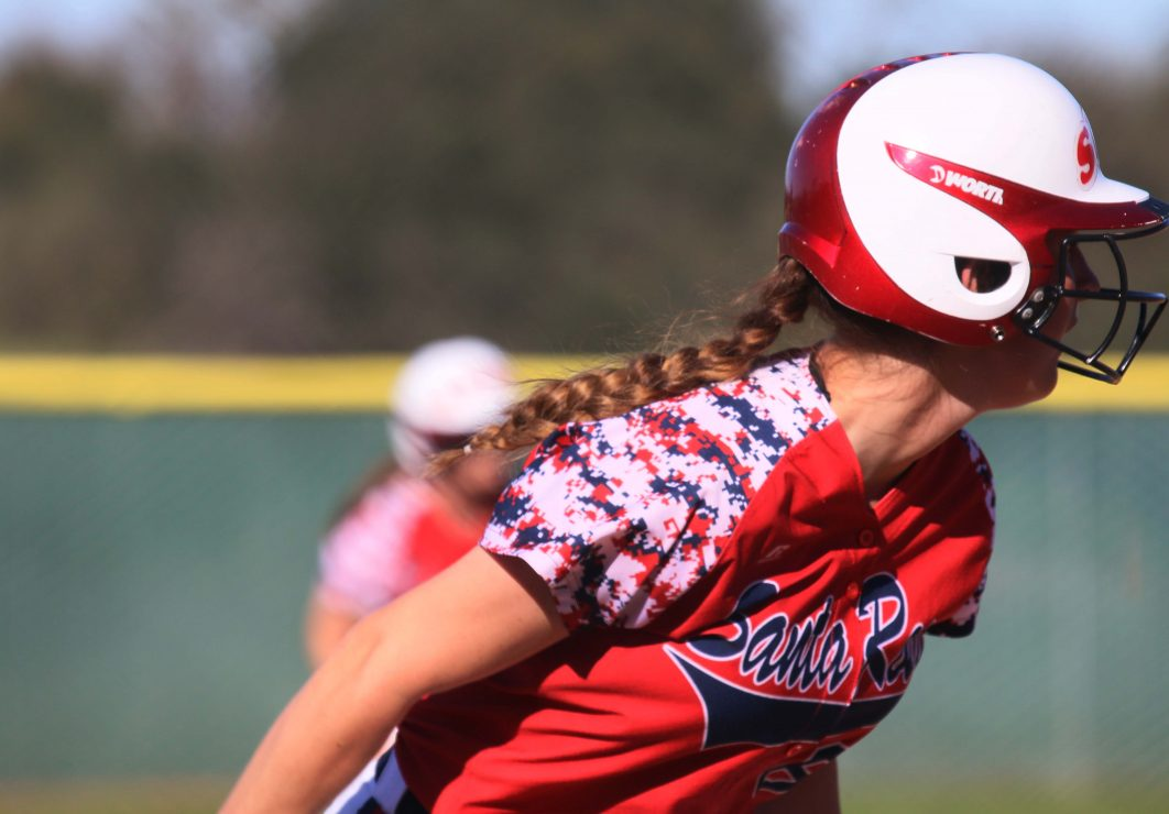 Santa Rosa softball player follows the ball with her gaze. (Photo Gallery by Lidiya Grib)
