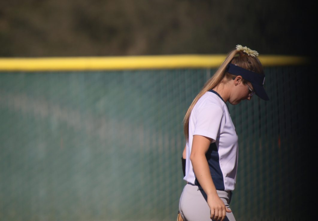 ARC softball player walks across the field. (Photo Gallery by Lidiya Grib)