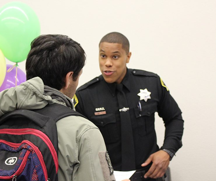 A Sacramento County sheriff speaks to an eager student.