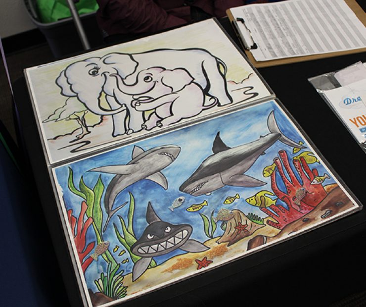 Artwork showcased at the early childhood education table.