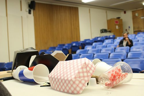Don Reed presents ARC garbage to his audience during college hour. (Photo by T.J. Martinez)
