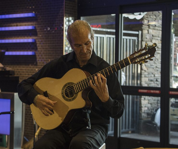 Guitarist Roberto Corrias performs at the Koreana Plaza in Sacramento, California on April 29. Corrias is an Italian-born guitar instructor that has been performing music for over 30 years. (Photo by Luis Gael Jimenez)