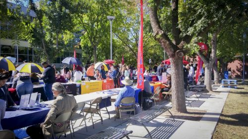College booths are set up on Transfer Day at American River College in Sacramento, California on Sept. 21, 2017. (Photo by John Ennis)