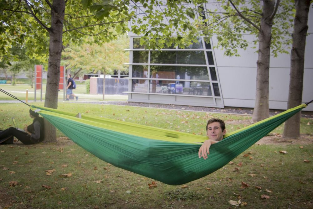 David Cocker lays in a hammock at American River College on Sept. 20, 2017. (Photo by Ashley Hayes-Stone)