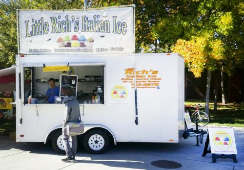 A student buys a Italian ice cream from Little Rich's Italian Ice at American River College at Sacramento, California. (Photo by John Ennis)