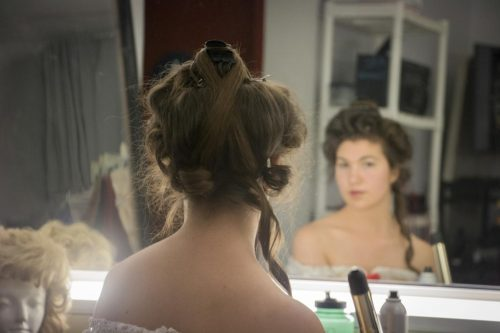 Actress Elizabeth Garbe gets ready for a dress rehearsal for American River College's production of