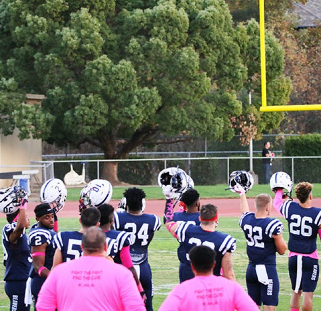 ARC Beavers raised their helmets at the end of the Pledge of Allegiance at the start of a game versus the Feather River Golden Eagles on October 28, 2017. (Photo by John Ennis)
