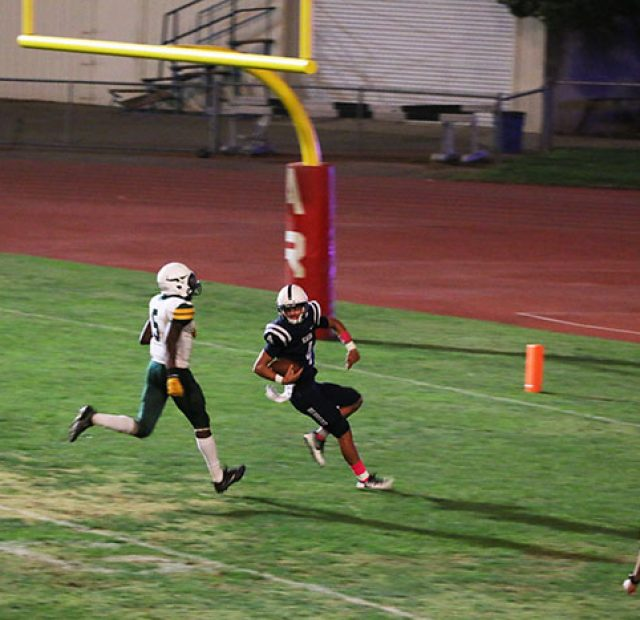 Quarterback Hunter Rodrigues scores a touchdown against the Feather River Golden Eagles. The American River College Beavers defeated the Feather River Golden Eagles 59-8 on October 28, 2017. (Photo by John Ennis)