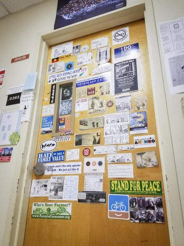 The door of Professor Kristina Casper-Denman's office disrupts the monotony on the Davies Hall's third floor with its collection of inspirational quotes and various stickers at American River College on Nov. 6. (Photo by Ashley Hayes-Stone)