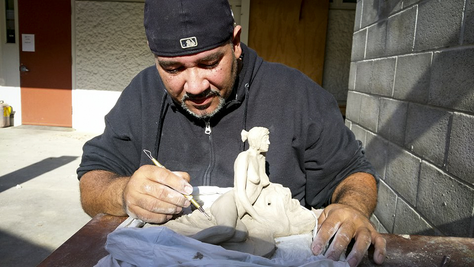 Manuel Marmolejos is working on his sculpture during his Figure Sculpting 375 class at American River College on Nov. 21. (photo by Ashley Hayes-Stone)