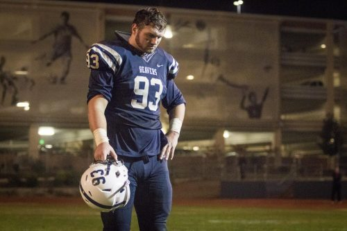 Defensive tackle Caleb Tremblay stands on the sidelines after the loss against San Mateo at American River College on Nov. 25. (Photo by Ashley Hayes-Stone)