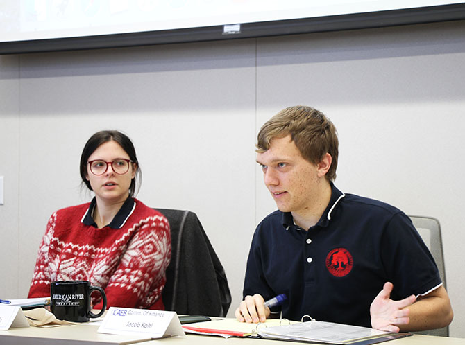Student Senate President Deborah Hernandez, CAEB President Mariana Topich and CAEB Commissioner of Finance Jacob Kohl at the November 28, 2017 CAEB meeting. (Photo by John Ennis)