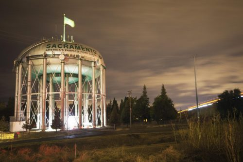 The Sacramento Water Towers illuminated by drivers on Interstate 5 on Nov. 13. The 'Welcome to Sacramento' water tower sits in the Pocket-Greenhaven neighborhood. (Photo by Luis Gael Jimenez)