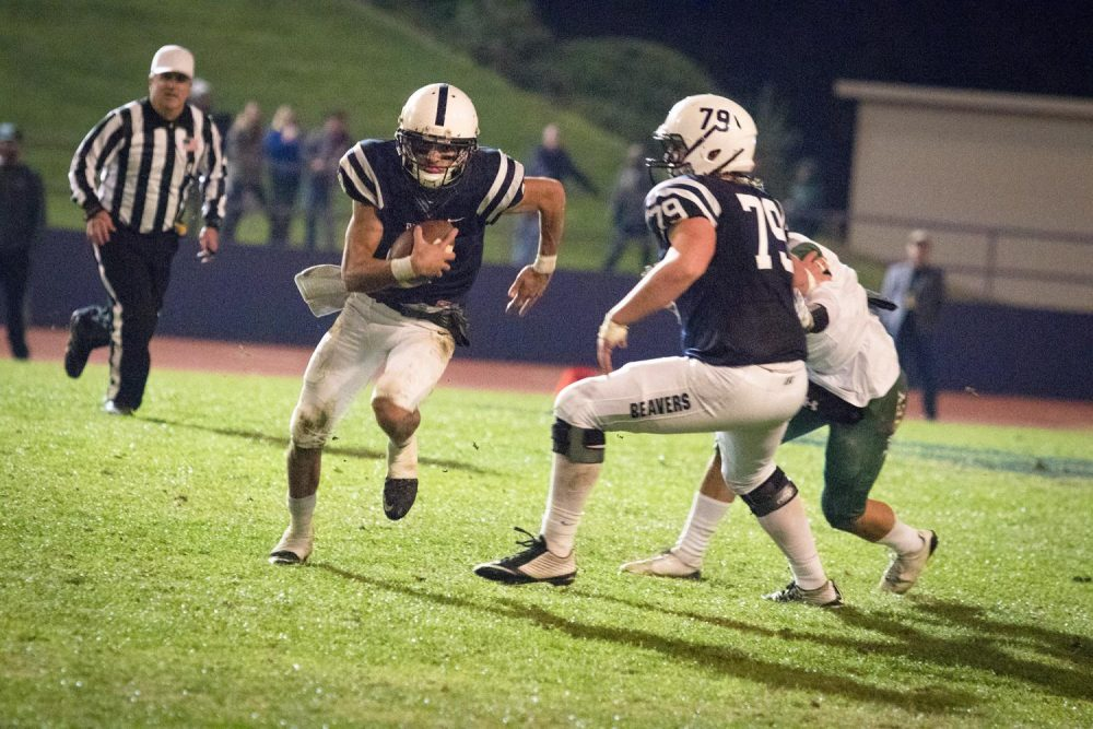 Quarterback+Hunter+Rodrigues+scrambles+for+a+first+down+during+American+River+College%E2%80%99s+41-35+win+over+Laney+College+on+Nov.+18.+%28Photo+by+Ashley+Hayes-Stone%29