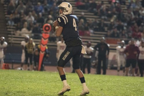 Quarterback Hunter Rodrigues prepares to launch a pass against Sierra College on Nov. 11. (Photo by Ashley Hayes-Stone)