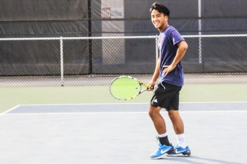 Tennis Player Cody Duong prepares for a practice session at American River College. (Photo by Lily Rodriguez Drake)
