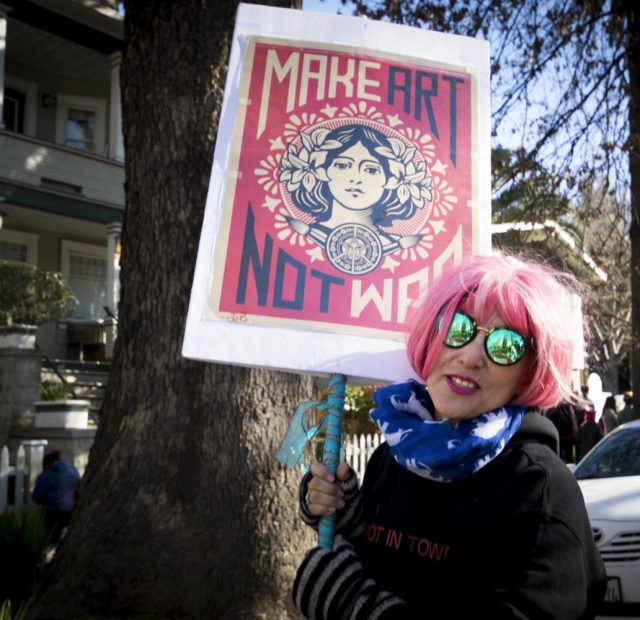 Maria Vargas poses with her sign at Southside park during the 2018 Women's March on Jan. 20 in Sacramento, California.