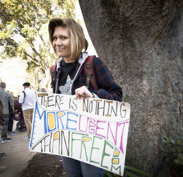 Grace Loescher poses with her sign at the 2018 Women's March on Jan. 20, 2018 in Sacramento, California.