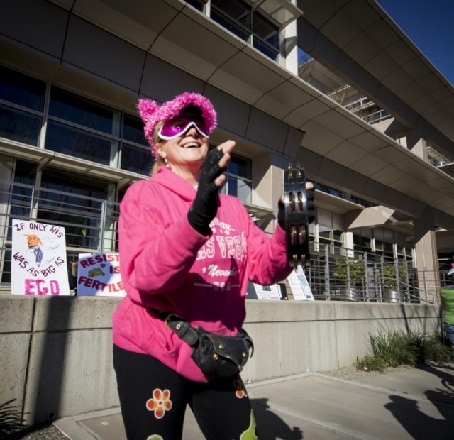 Bablou cheers on the protesters during their walk to the Capitol on Jan. 20, 2018 in Sacramento, California.
