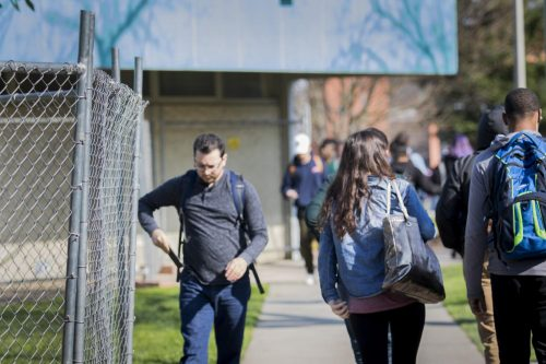 American River College students walk by the fenced-off Liberal Arts building on Feb. 7 in Sacramento, California. The Liberal Arts building at American River College will be torn down and be replace with the new S.T.E.M building.(Photo by Ashley Hayes-Stone)