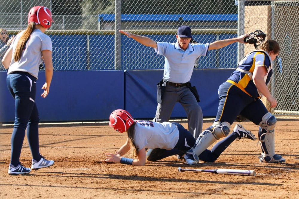 American River College catcher/infielder Rylee Owen is ruled safe at the plate during a doubleheader softball game against Merced College on Jan 27. at ARC. The Beavers won both games with a combined score of 17-1. (Photo by Tracy Holmes)