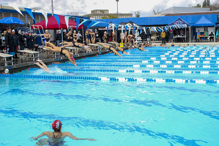 Women's swim teams from eight community colleges across northern California, push off the block for their first time trials of the Big 8 swim invite on March 15 at ARC.  (Photo by Cecilia Castillo Juarez