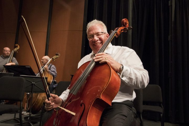 David Brooks poses with his cello during the American River College Orchestra's rehearsal on Mar. 8 at American River College.(Photo by Ashley Hayes-Stone)