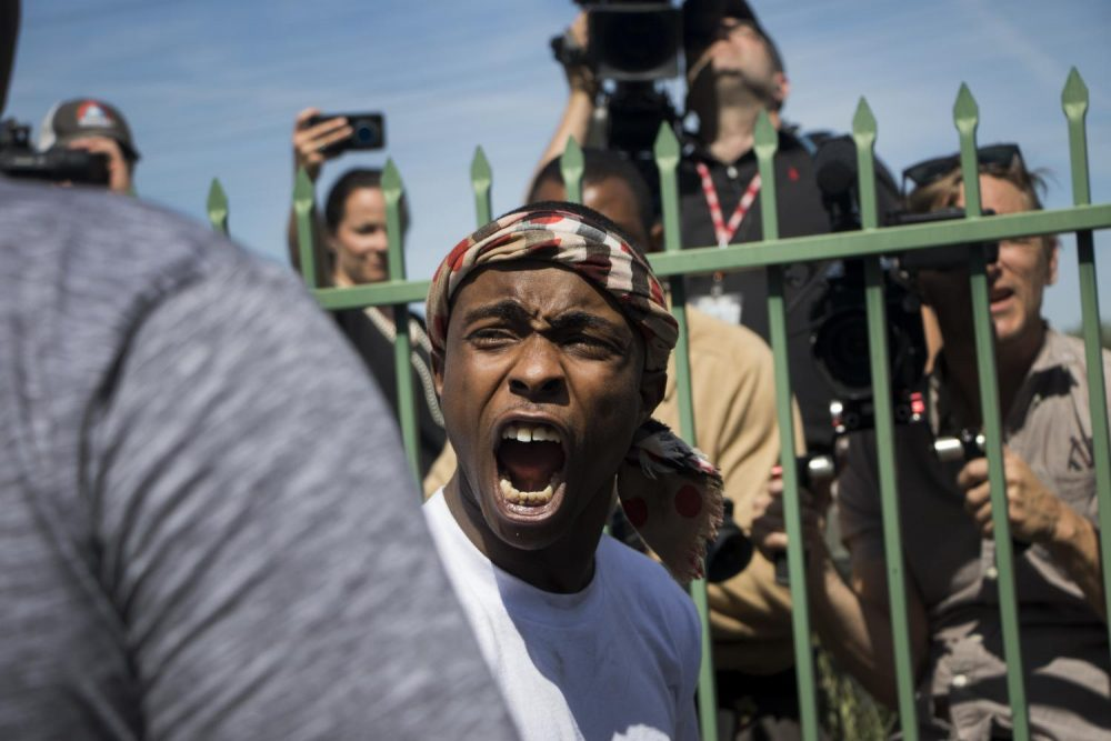 Stevante Clark yells at the media during his brother Stephon Clark's funeral at the Bayside of South Sacramento Church on March 29, 2018. (photo by Ashley Hayes-Stone)