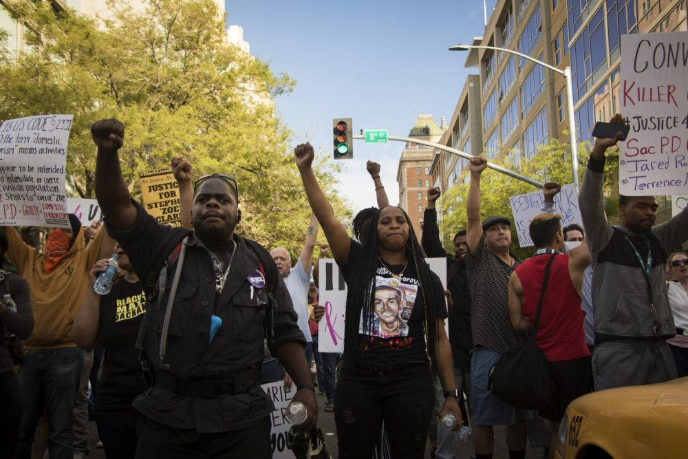 Demonstrators+raise+their+fists+as+they+block+the+intersection+of+J+and+8th+in+protest+of+Stephon+Clark%27s+death+on+March+29%2C+2018.+%28photo+by+Ashley+Hayes-Stone%29