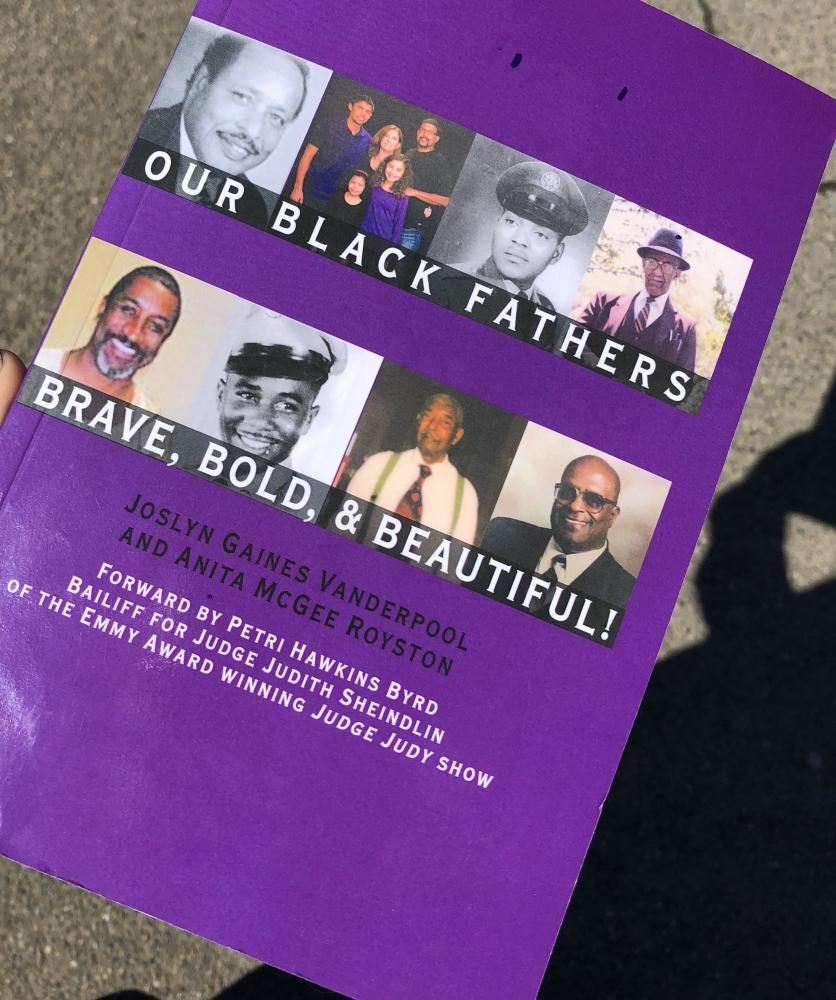 A+copy+of+%22Our+Black+Fathers+Brave%2C+Bold%2C+%26+Beautiful%22+written+by+Joslyn+Gaines+Vanderpool+and+Anita+Mcgee+Royston+sits+on+display.+%28Photo+by+Alexus+Hurtado%29