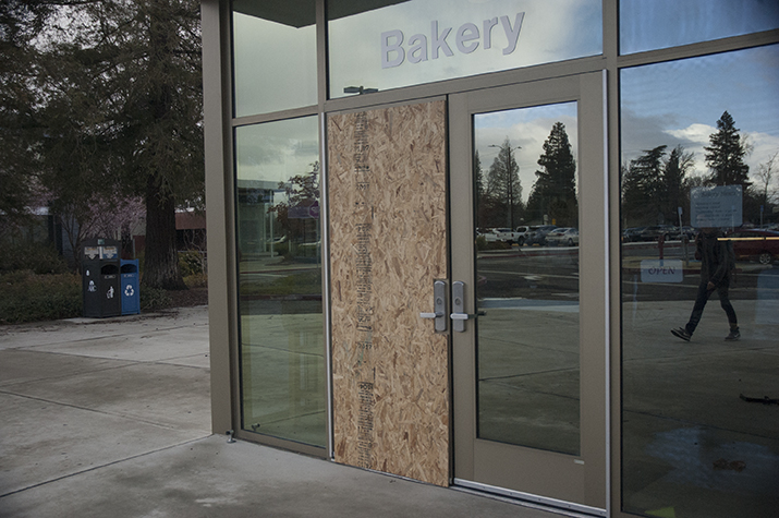 A piece of plywood covers one of the doors to the Oak Cafe on March 2 at ARC. The cafe was broken into on Feb. 24. (Photo by Brienna Edwards)