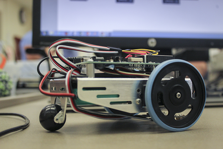 A student built robot sits on a desk during an electronics technology midterm on Feb. 28 at ARC. Students had to build a robot from a kit that would follow a black line along the ground. (Photo by Mack Ervin III)