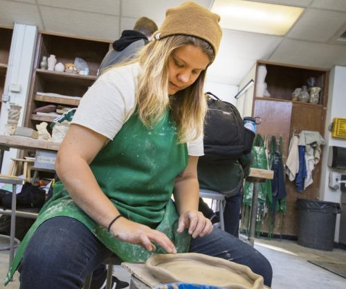 Ceramic student Taylor Bacon uses the wheel to create a plate on Nov. 7, 2017 at American River College. (Photo by Ashley Hayes-Stone)