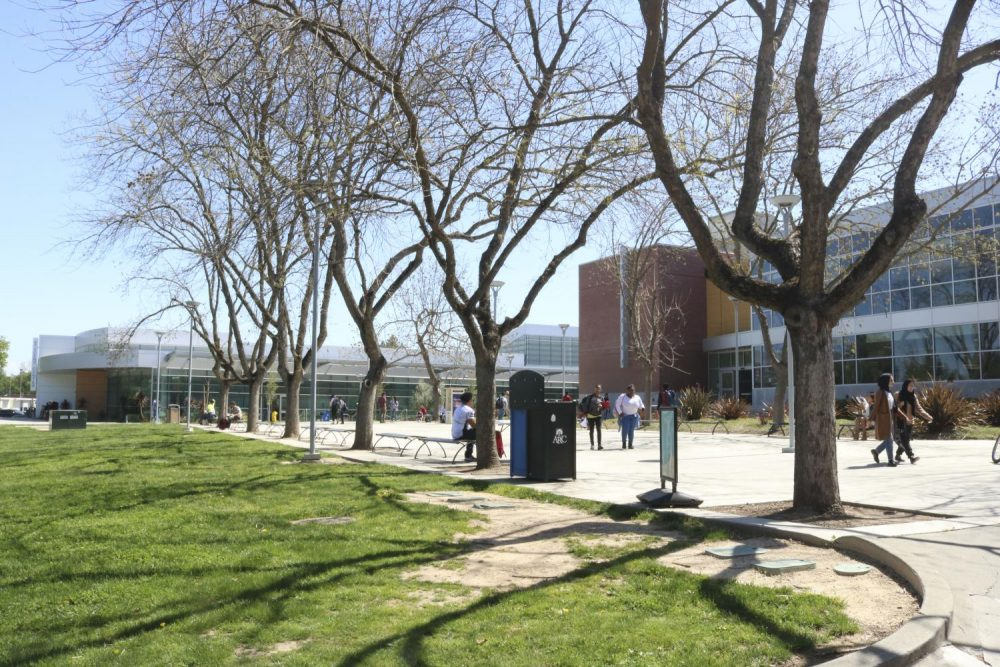 Students walk in front of the American River College library during the first day back from spring break on April 2, 2018.