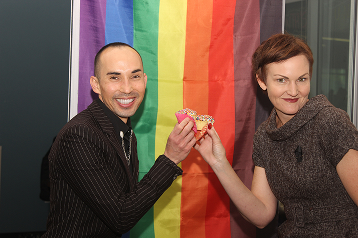 Joshua Moon Johnson and Emilie Mitchell cheer cupcakes to celebrate the opening of the Pride Center on April 5, 2018. (Photo by Tracy Holmes)