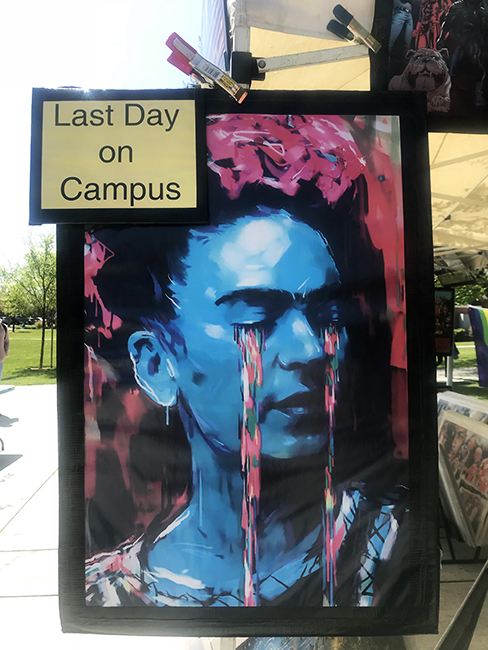For Spirit Week Richard Hughes sells art outside of American River College's Student Center on April 12, 2018. (Photo by Alexis Warren)