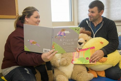 American River College's Childhood Development Center employees Jennifer Lewin and Vasyl Ivanov read to each other on April 6, 2018. (Photo Illustration by Ashley Hayes-Stone)