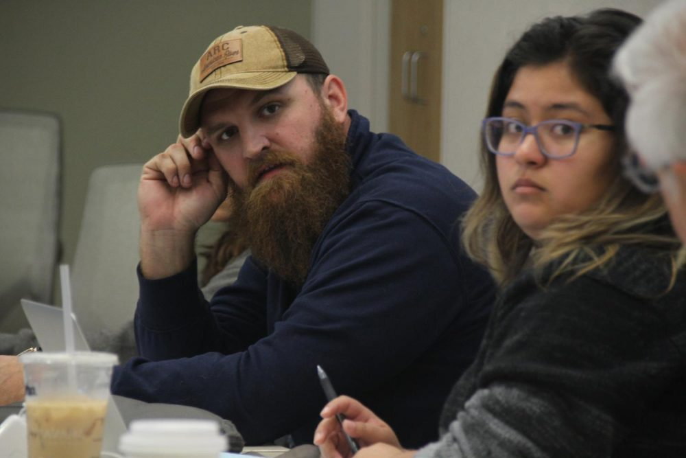 Vice President Earl Crouchley III (left) and President Deborah Hernandez look on as someone speaks during an April 6 ASB meeting. (Photo Mac Ervin III)