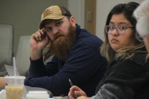 Vice President Earl Crouchley III (left) and President Deborah Hernandez look on as someone speaks during an April 6 ASB meeting. (Photo Mac Ervin III)