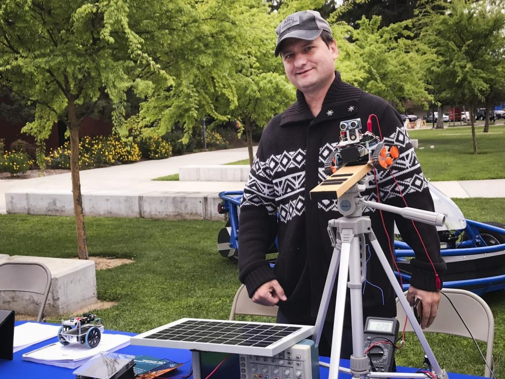 Lab assistant and Electronic Technology major, Taras Valaga poses with his robot at American River College on April 18, 2018. (photo by Tracy Holmes)