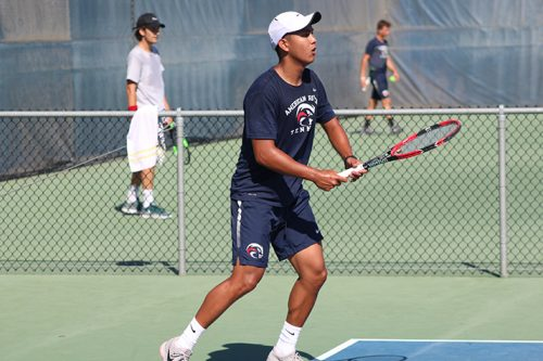 Sophomore Michael Vizcarra waits for a return ball during a match against De Anza College on April 21 at American River College. Vizcarra won his match 6-4, 6-3 as ARC won their third straight NorCal title. (Photo by Mack Ervin III)