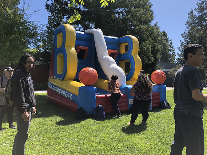ARC students enjoying some inflatables during the Rock Out to Knock Out Stigma event on April 19. (Photo by Alexus Hurtado)