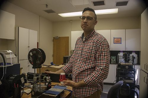 Thomas Pfingston shows how his additions will convert a regular 3-D printer into a chocolate 3-D printer on April,23,2018. ( Photo by Brienna Edwards)