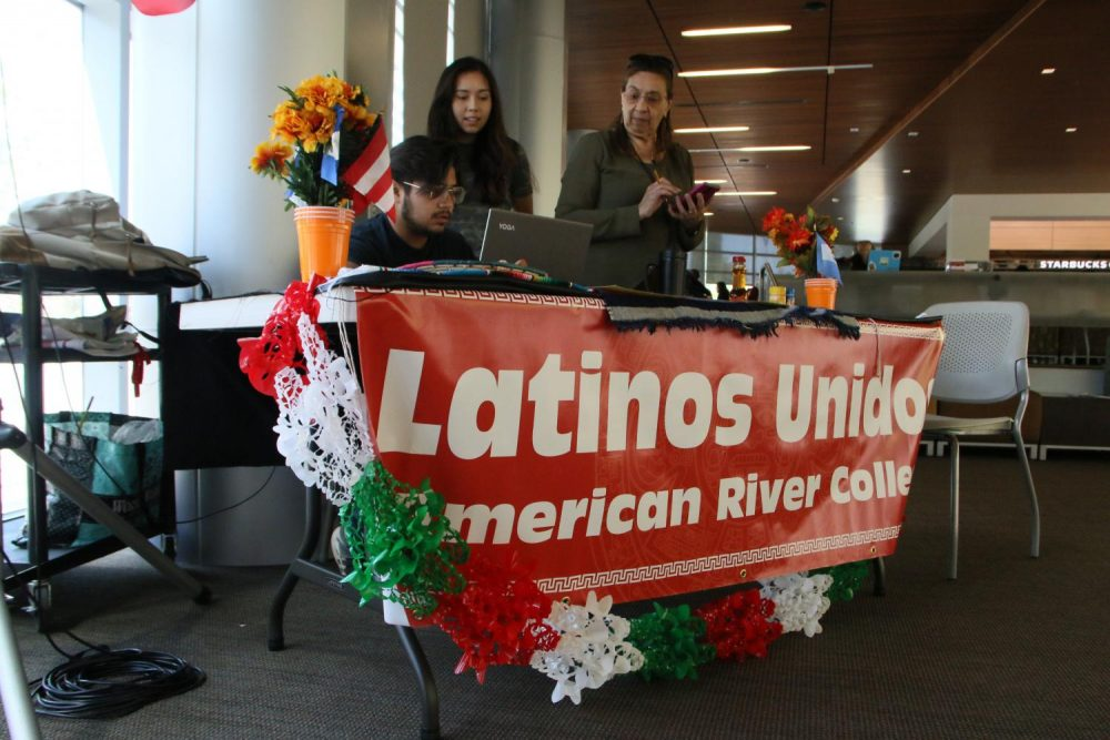 Members of Latinos Unidios at American River College behind an information booth regarding Cinco De Mayo on April 24, 2018. (Photo by Michael Pacheco)