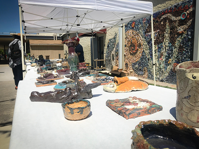 Ceramic works created by students are sold by the art department in front of ARC's Fine & Applied Arts buildings and theater on May 8. (Photo by Hannah Yates)