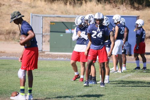 American River College fooball defensive backs look on at practice before their first game on Saturday, Sep. 1. (Photo by Jennah Booth)